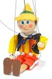 A boneca senta-se Imagens de Stock