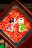 Bonecas da argila - amor em China Fotografia de Stock
