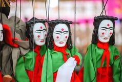 Bonecas da máscara em cordas imagens de stock royalty free