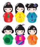 Bonecas de Kokeshi ilustração do vetor