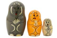 Bonecas do assentamento sob a forma de um lobo, de uma raposa e de uma lebre Foto de Stock Royalty Free