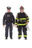 Bonecas do bombeiro e de um polícia Fotografia de Stock