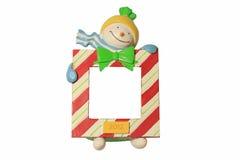 Boneco de neve bonito que mantem o sinal em branco Imagens de Stock Royalty Free