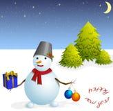 Boneco de neve com bolas do Natal e um presente imagem de stock