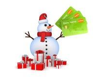 Boneco de neve com cartões e caixas de presente de crédito. Imagens de Stock