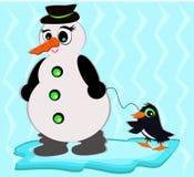 Boneco de neve com pinguim do animal de estimação Foto de Stock Royalty Free