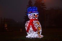Boneco de neve das luzes Vista dianteira, noite fotos de stock