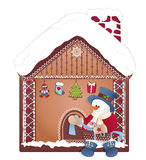 Boneco de neve do Natal com a casa do presente e do gengibre Fotografia de Stock Royalty Free