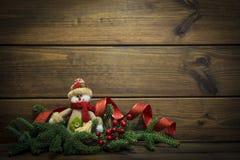 Boneco de neve do Natal no fundo de madeira Imagens de Stock Royalty Free