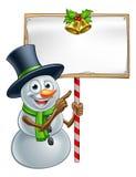 Boneco de neve do Natal que guarda o sinal Imagens de Stock