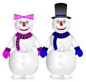 Boneco de neve e mulher da neve Fotografia de Stock Royalty Free