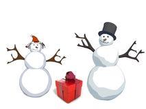 Boneco de neve e mulher da neve com caixa de presente Fotografia de Stock