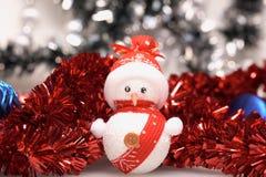 Boneco de neve e ouropel Imagens de Stock Royalty Free