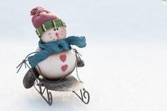 Boneco de neve em um trenó Fotografia de Stock