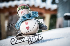 Boneco de neve em um trenó Foto de Stock Royalty Free