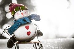 Boneco de neve em um trenó Imagem de Stock