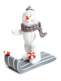 Boneco de neve em um trenó Fotos de Stock Royalty Free