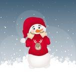 Boneco de neve escondendo em um pulôver impresso vermelho Imagens de Stock