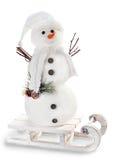 Boneco de neve no trenó no fundo branco Imagem de Stock Royalty Free