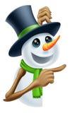 Boneco de neve que mostra a mensagem do Natal Fotografia de Stock Royalty Free