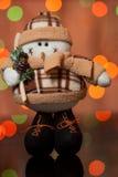 Boneco de neve - um brinquedo do Natal em um abeto Fotografia de Stock Royalty Free