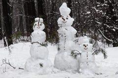 Bonecos de neve da família Fotografia de Stock