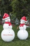 Bonecos de neve do Feliz Natal Fotografia de Stock Royalty Free
