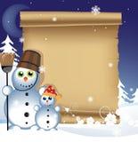 Bonecos de neve em um fundo do inverno Fotografia de Stock