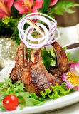 Boned roasted ribs served. Royalty Free Stock Photo