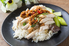 Boned, sliced Hainan-style chicken with marinated rice Stock Photo