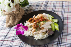 Boned, sliced Hainan-style chicken with marinated rice Stock Image