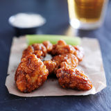 Boneless barbecue chicken wings with beer on slate surface Stock Photo