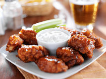 Boneless buffalo bbq chicken wings. With ranch sauce and beer stock photos