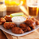 Boneless buffalo bbq chicken wngs with ranch sauce and beer Royalty Free Stock Photos
