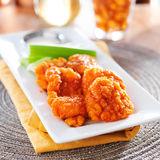Boneless buffalo flavored chicken wings Royalty Free Stock Photos