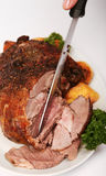 Boneless roast lamb being carved stock photography