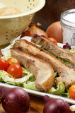 Boneless streaky slices with salad Royalty Free Stock Image