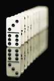 Bones of dominoes on a black background Stock Image