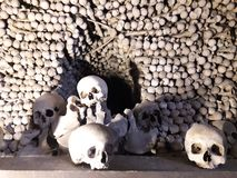 Bones and human sculls placed in an ossuary being a morbid symbol of death. In Central European medieval institution stock photos