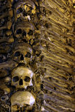 Bones and Skulls. Photo of a wall in a chapel fully covered with human bones Stock Photos