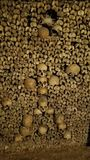 Artistic Arrangement of Skulls In The Catacombs of Paris. When the bones were moved from individual cemeteries to the Catacombs of Paris, some were artistically Stock Photography