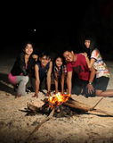 Bonfire. People fun at beach with bonfire at night time royalty free stock photography
