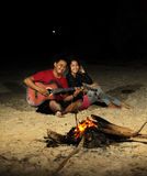 Bonfire. People fun at beach with bonfire at night time stock photography