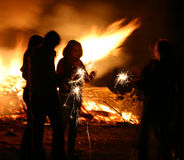 Bonfire 2. People around a bonfire, Guy Fawkes Night, blur stock images