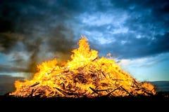 Bonfire. Huge wood fueled bonfire burning at sunset Stock Photo