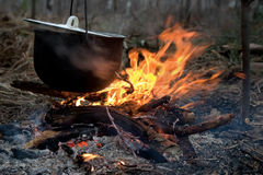 Bonfire. The hunting bonfire with the kettle suspended above him Royalty Free Stock Photos