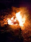 Bonfire in backyard between rocks and grass in night stock images
