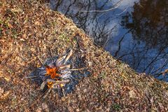 Bonfire on the banks of the creek in the spring forest. View from above royalty free stock photos
