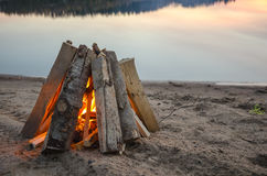 Bonfire on the beach sand Royalty Free Stock Image