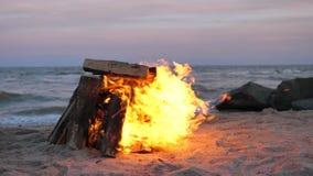 A bonfire is burning on the beach